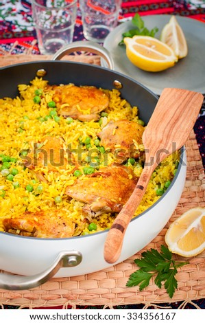 Chicken Thigh and Rice Biryani with Green Peasin a Skillet - stock photo