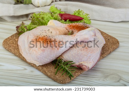 Chicken thigh with rosemary, pepper and salad leaves - stock photo