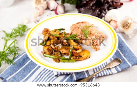 Chicken Tights Baked and Served with Sauteed Potatoes, Mushrooms, Green Beans for Healthy Meal - stock photo