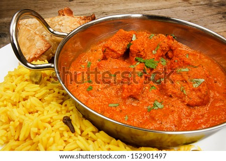 Chicken Tikka masala a popular indian curry developed in Europe as a fusion of Eastern food and modern western tastes - stock photo
