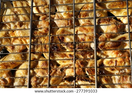 Chicken wings and Juicy roasted kebabs and on the barbecue top view surface                                 - stock photo