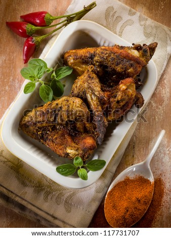 chicken wings baked with paprika spice - stock photo