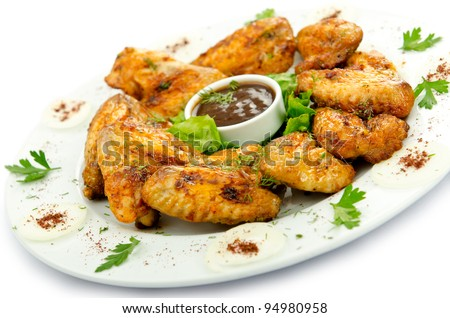 Chicken wings barbeque in the plate - stock photo