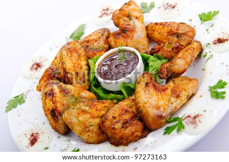 Chicken wings in the plate - stock photo