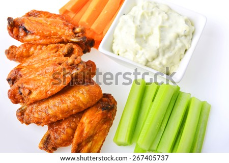 chicken wings with celery, carrot and blue cheese sauce - stock photo