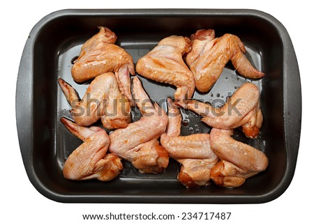 Chicken wings with sauce for baking. Isolated - stock photo
