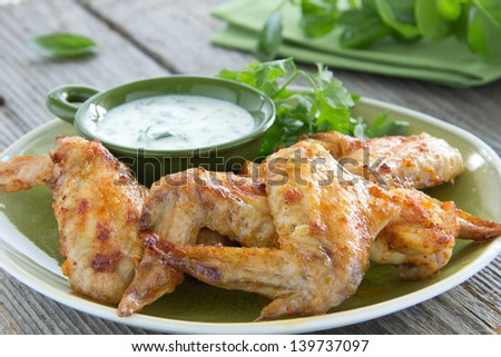 Chicken wings with sauce of yogurt. - stock photo