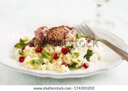 Chicken with couscous - stock photo