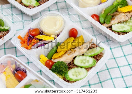 Chicken with garlic and pepper and vegetable salad thai cuisine put in a modern plastic box. choose on focus - stock photo