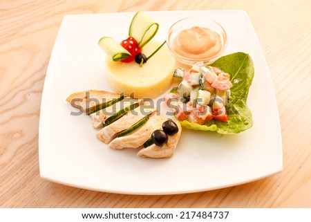 chicken with mashed potatoes for kids menu - stock photo