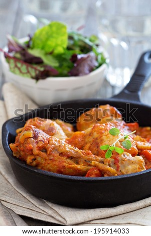 Chicken with mustard and red peppers in tomato sauce - stock photo