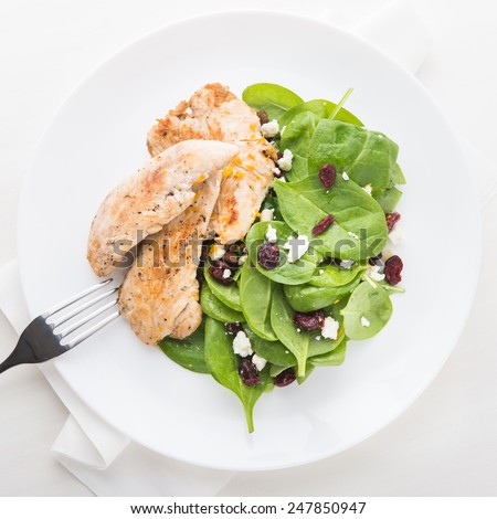 Chicken with spinach salad top view. Healthy food. - stock photo