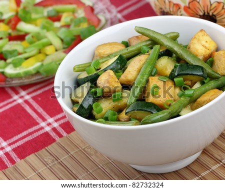 Chicken with zucchini and green beans - stock photo