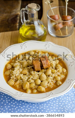 Chickpea stew with rice and chorizo - stock photo