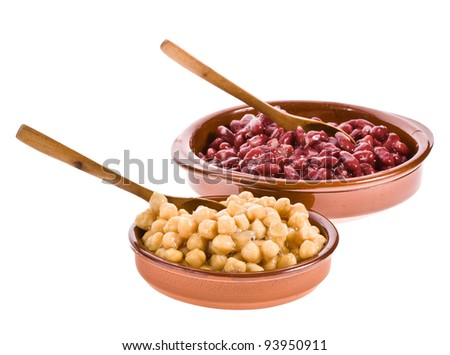 Chickpeas and red beans in bowls made ??of clay with a wooden spoon on white background - stock photo