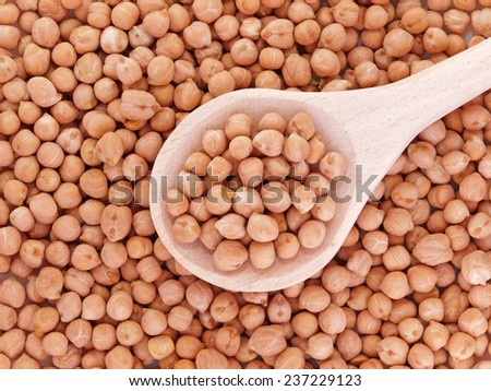 chickpeas in wooden spoon - stock photo