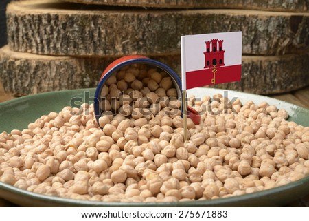 Chickpeas or Garbanzo Beans With Gibraltar Flag - stock photo