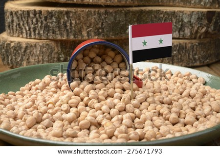 Chickpeas or Garbanzo Beans With Syria Flag - stock photo