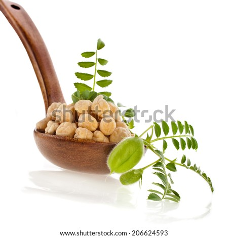chickpeas seed over  spoon isolated on white background - stock photo