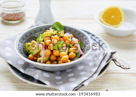 chickpeas with onions and avocado slices, food closeup - stock photo