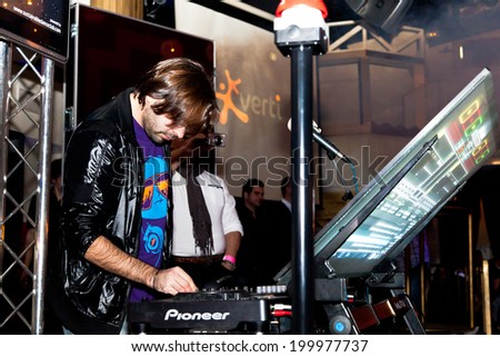 CHICLANA, SPAIN - JAN 27: DJ Alvaro Reina next to the mixer to begin the party of the hot mix energy danceflor of the Los 40 Principales  on Jan 27, 2012 in Chiclana, Spain - stock photo