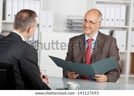 Chief of staff reviewing the information of applicant in the office - stock photo