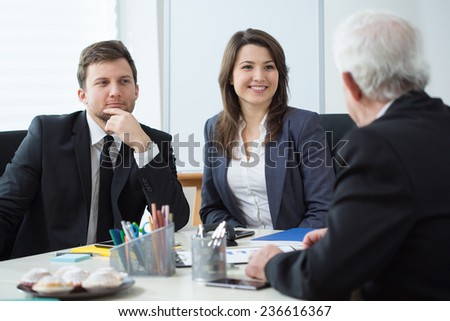 Chief talking with his employees on business meeting - stock photo
