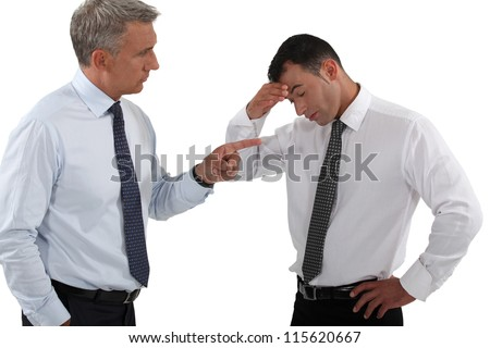 Chief taunting employee - stock photo