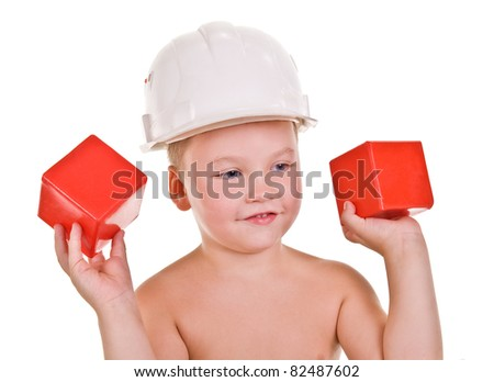 child a builder.boy with red blocks on a white background - stock photo