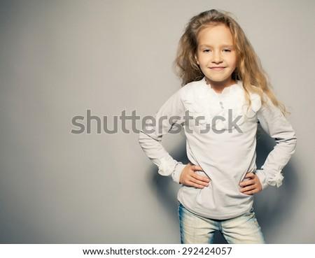 Child about school board. Girl near blackboard - stock photo