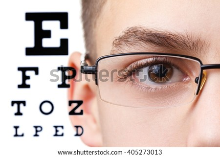 Child an ophthalmologist .Portrait of a boy with glasses.  Eye exams. Check Table view. Macro studio shoot profile - stock photo