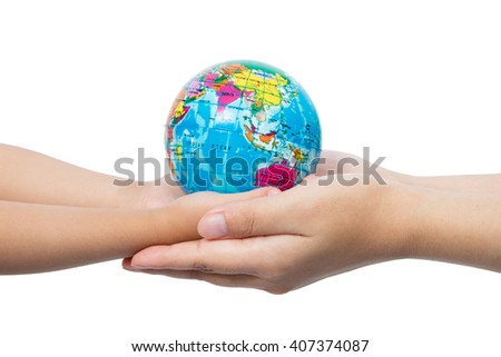 Child and Adult Holding a World Globe in Hands in isolated White Background - stock photo