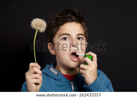 child and dandelion on black background - stock photo