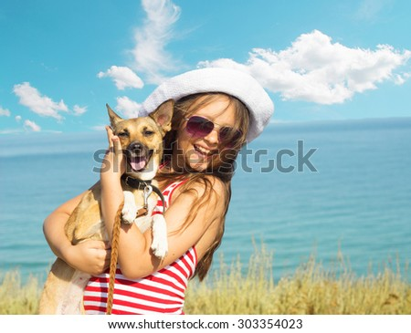 child and dog and sea - stock photo