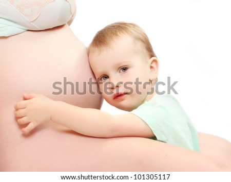 Child and her pregnant mother. Happy family concept. - stock photo