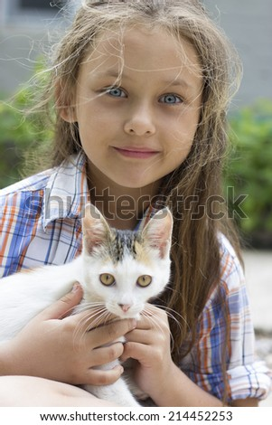 child and kitten - stock photo