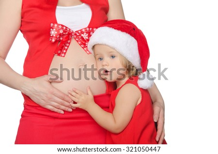 child and pregnant woman in Christmas clothes isolated on white - stock photo