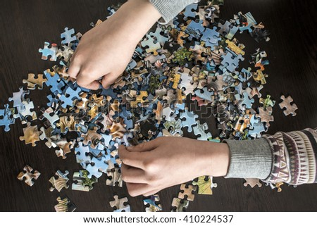 Child and puzzle.  - stock photo