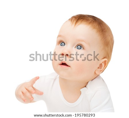 child and toddler concept - curious baby lying on floor and looking up - stock photo