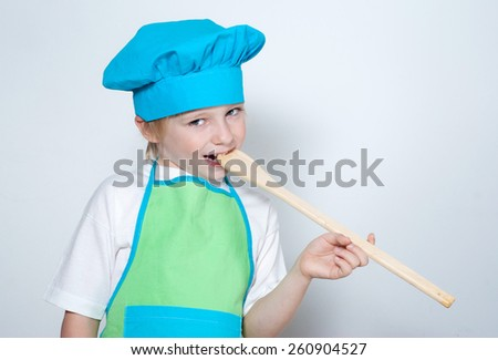 Child as a chef cook - stock photo