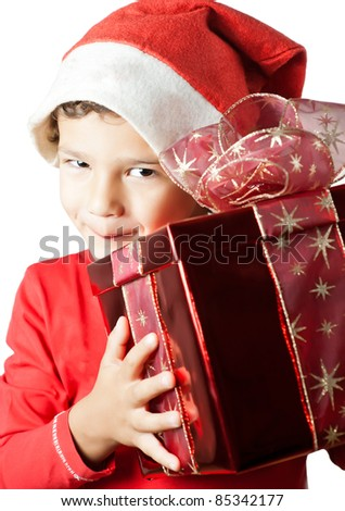 Child as Santa Claus smiling and holding a gift - stock photo