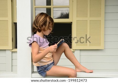 Child at home reading book of children stories - stock photo