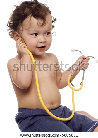 Child at the doctor,playing with stethoscope. - stock photo