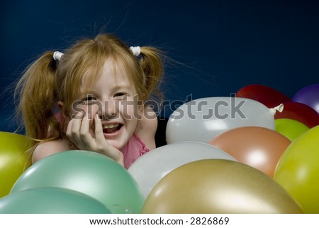 Child between the balloons - stock photo