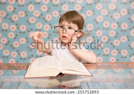child ,book,glasses - stock photo