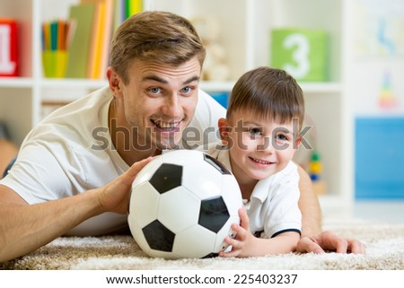 child boy and father playing with football - stock photo