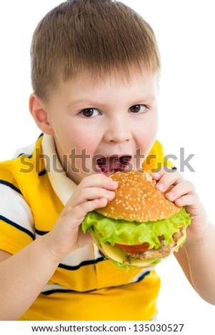 Child boy eating hamburger - stock photo