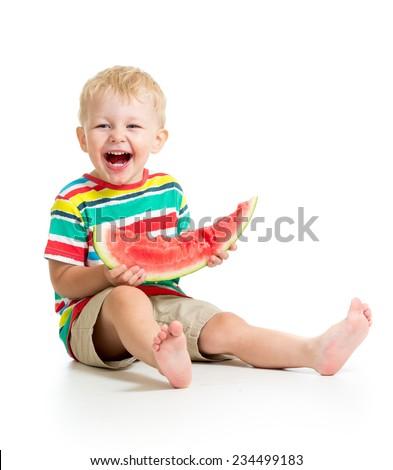 child boy eating watermelon isolated on white - stock photo