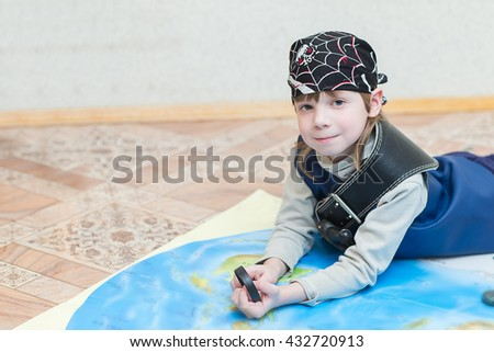child boy playing pirate. Pirate costume on a child. The captain of a pirate ship. - stock photo