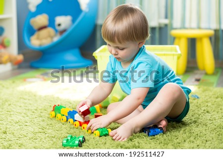 child boy playing with block toys indoor - stock photo